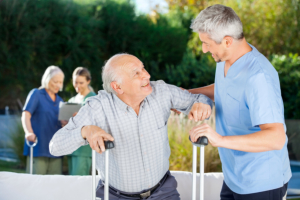 man assisting senior man